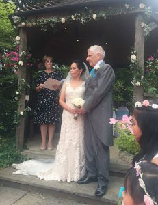 Helen Waters conducts outdoor wedding